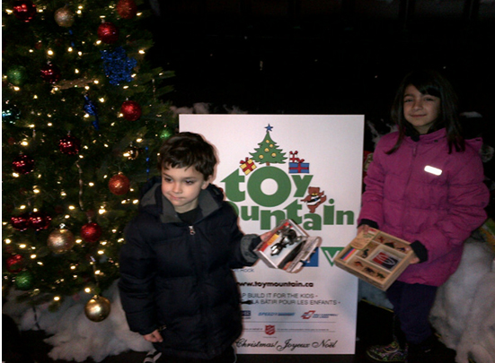 Children of Office of the Procurement Ombudsman employees help deliver the toys to Ottawa's Toy Mountain toy drive.