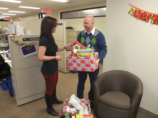Office of the Procurement Ombudsman employees pack Christmas hamper packages to be delivered to two local families through les Centres jeunesse de l'Outaouais' Bright Christmas Project.