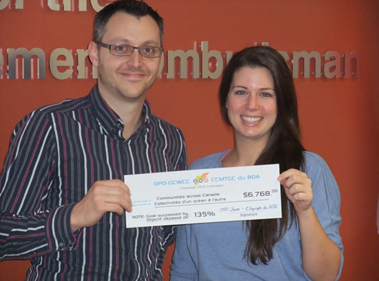 OPO Workplace Charitable Campaign Team poses with a cheque representing OPO's achievement in 2012.